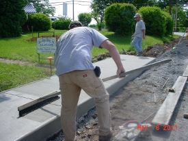 Men Working on Putting in Sidewalk