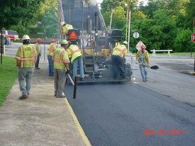 Staff Laying Down Asphalt
