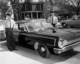 Historical Photo of Two Officers Next to Police Car